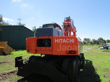 Экскаватор колесный Hitachi W210 2006 года
